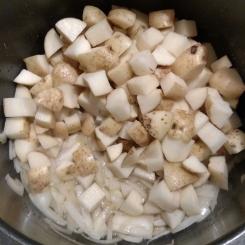 Boiling potatoes.
