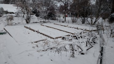 Raised beds under snow.