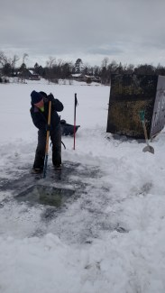 Cutting through the ice with an ice saw