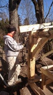 L. Hamvas hammering a peg home.