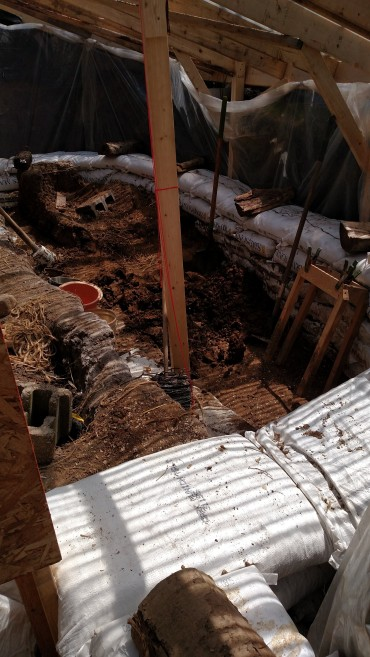 Work on the walipini greenhouse continues.