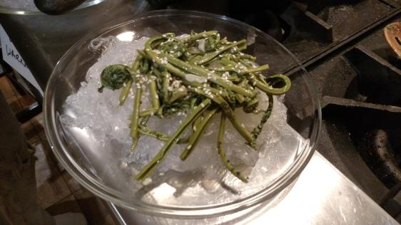 Fiddlehead ferns over noodles.