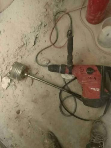 Hammerdrill with cup bit.